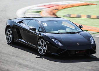 Try a Lamborghini Gallardo on racetrack with Puresport in Magione